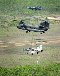 Australian Chinook slings an old two seat Mirage fighter down to Tyndal Air Force base for restoration.