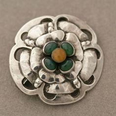 Brooch | Georg Jensen.  Handmade; sterling silver with amber and chrysophase.  Design no 9 | ca. 1904 - 1908 #ClayJensenSterlingSilver #SterlingSilverTiffanyJewelry