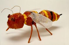 Papier Mache bugs. Wings are cheesecloth dipped in glue!  Legs are soda straws with floral wire inside. Nice!