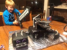 Minecraft Ender Dragon cake. Secret tip: the nose, neck, and legs were made with little Debbie Swiss cake rolls cut and wrapped in fondant. The wings were cardboard wrapped in fondant