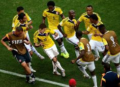 James Rodriguez of Colombia celebrates by dancing with teammates after scoring his team's first goal during the 2014 FIFA World Cup Brazil Group C match between Colombia and Cote D'Ivoire at Estadio Nacional on June 2014 in Brasilia, Brazil. James Rodriguez Colombia, World Cup 2014, Fifa World Cup, Lionel Messi, Soccer Players, Football Soccer, Football Jokes, Rio 2014, Football Celebrations