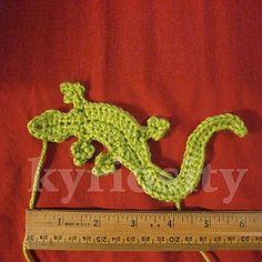 Here's a lizard applique pattern that'll fit on a hat or whatever other project you wish! I made my sample using Caron Simply Soft (aran weight) with a size E hook. As you can see, he's about 6 inches long. I'm sure he'd adapt well to other yarn weights and hook sizes.