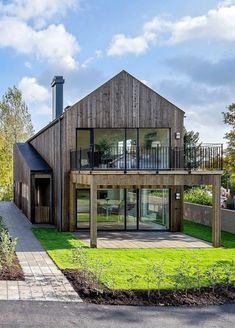 Check out the sight, but i love how warm this is compared to other modern barn homes: