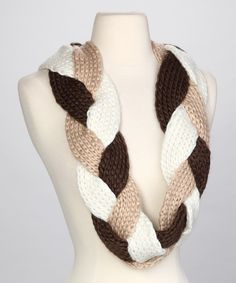 I need to try to make this. It's probably fairly simple . . . just crochet/knit three long, skinny scarves and then braid them together. Even *I* could do that.