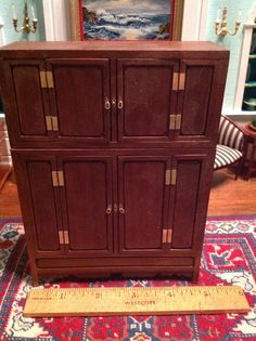 Bill Helton - Oriental cabinet, top portion and bottom portion are actually separate pieces, bottom piece has a hidden drawer in the back; sold on ebay for $69