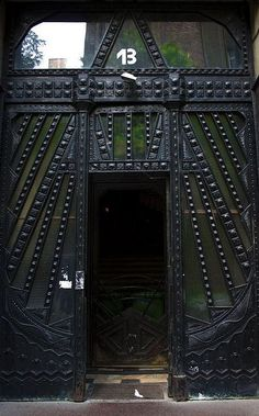 #13. This black door with dark green panels is amazing! The raised detail gives it the apearance of armor. It is located in Budhapest