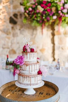 Copper drip semi naked wedding cake with pink peonies and roses and 'Best Day Ever' topper | Luke Simon Photography