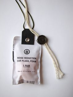 Useful clothing tags. Who needs those extra buttons? What about a pair of ear plugs with your new pajamas?