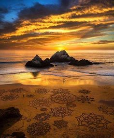 Sunset and sand art, Ocean Beach, San Francisco