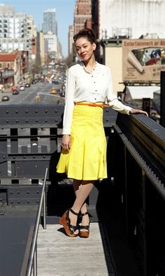 An icon of city life in sunny yellow cotton, this pleated skirt will have you favoring city strolling over cab-hailing. Paired easily with e...
