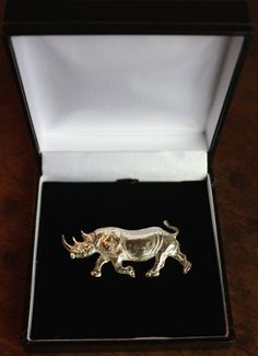Silver Wild Animals and Wild Life sculpture by artist Camilla Le May titled: 'Silver Rhino brooch (Animal Hall Marked Jewellery Adornment)'