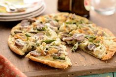 thin crust pizza with onions,asparagus and sausage.  great recipe and info on King Arthur's Flour blog