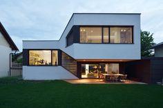 elastik + hikikomori's mezzanine house in ljubljana uses a cantilever to shelter exterior terrace