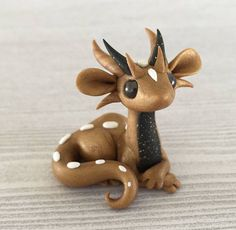 Gold scrap dragon by Dragonsandbeasties
