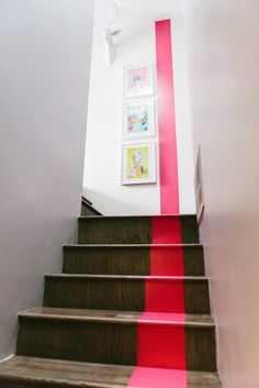 Up the basement stairs. Using Red Stripe same color as wall. (not on wall thought). Stairs a brown or taupe that works with the carpet.