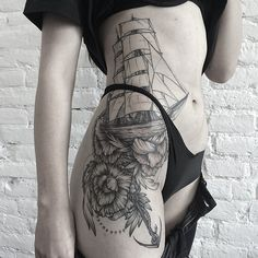 Gorgeous linework nautical tattoo by Sasha Masiuk.