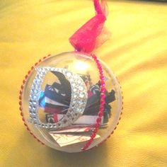 couples first christmas ornament made with their invite inside their wedding colors used hung by a sparkly ribbon great gift idea for those newlyweds