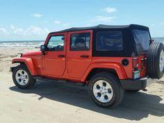 Sunset Orange Pearl Wrangler Unlimited 4x4 running Texas beaches