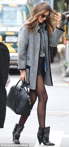 Miranda Kerr. It's no secret that her Isabel Marant boots are covet-worthy and keep her from being a haute mess.