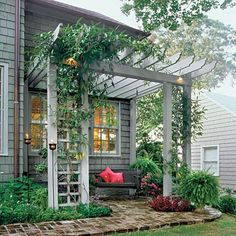 patio at back of house with overhead arbor