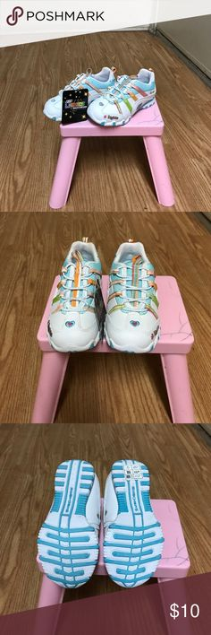 Little girls sketchers shoes Sketchers little girl shoes.. they light up when you walk they have a small rip in a little stain Skechers Shoes Sneakers