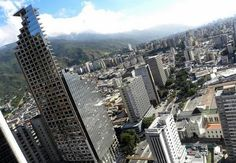 Thousands of people live in abandoned skyscraper    The Centro Financiero Confinanzas is also known as the David Tower named after its investor David Brillembourg. David Tower stands in downton Caracas, Venezuela and it's the country's third tallest skyscraper.