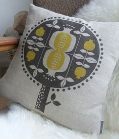 Image of pomegranate tree cushion in yellow on natural linen