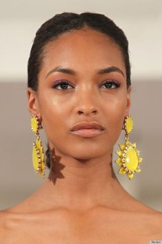 Gorgeous glow + Bold Earrings? LOVE. Our Favorite Beauty Looks From New York Fashion Week | theglitterguide.com