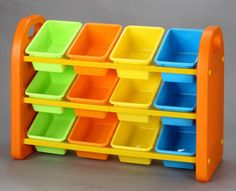 Our plastic children's toy storage organiser rack with bins is a great space saving piece of children's furniture to store all those toys, paints and art materials. This colourful kids storage unit is strong and features 12 compartments. Wall Basket Storage, Toy Storage Bench, Baskets On Wall, Storage Bins, Storage Containers, Storage Spaces, Storage Ideas, Easy Storage, Do It Yourself Organization