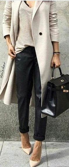 Love the long coat and pointed shoes.
