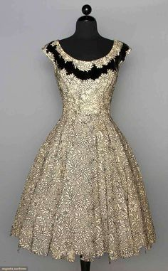 ELIZABETH ARDEN PARTY DRESS, c. 1955 White lace outlined in black & trimmed w/ rhinestones & black velvet band at neck, fitted, full skirt w/ irregular cutout hemline, labeled