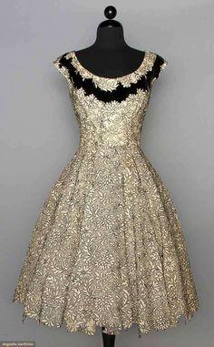 ELIZABETH ARDEN PARTY DRESS, c. 1955 White lace outlined in black & trimmed w/ rhinestones & black velvet band at neck, fitted, full skirt w/ irregular cutout hemline, labeled