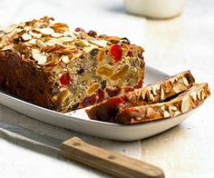 This delicious fruitcake recipe is filled with candied red cherries, chocolate, and nuts for a moist dessert that's perfect for Christmas or any occasion. /
