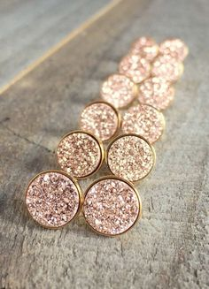 Gorgeous, rose gold colored druzy quartz coins are bezel set in gold vermeil ear posts with backs.  Natural, druzy stones are vapor coated with titanium to bring out a brilliant, consistent rose gold (pink gold) color. Each stud is 10 mm round. 18K gold vermeil bezel setting is polished to a high shine for a beautiful contrast in tone and texture. They are nickel free and suitable for sensitive ears. A wonderfully sparkly alternative to classic gold studs. The contrast in colors is so…