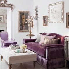 Purple sofa in a lovely room.  Perhaps a man in a purple butler suit is just around the bend?