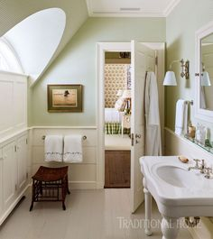 Charming vintage style bathroom in pale green and white. LOVE the built in cabinets and wainscoting. Dutch Colonial Home by Gil Schafer