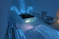 The Tron movie inspired hotel room in Sweden wouldn't sit too well with Feng Shui followers who believe in eradicating technology from the bedroom, as this space feels pretty much like you're sleeping in a computer chip, a very blue, glowing, computer chip.