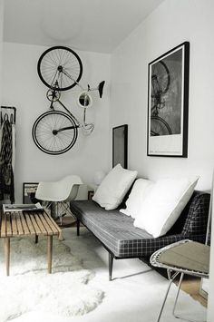 I love the set-up of this living space. Simple, yet it has everything one could possibly need to be cozy and comfortable. Plus, I love the bike storage!