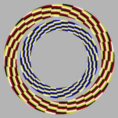 """""""Hoopla"""" O anel externo parece se expandir, o anel interno parece encolher. Se você olhar ao redor do anel com o aproximar ou afastar enquanto assistia a figura central nos olhos parecem mudar de cor do anel externo."""