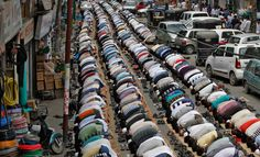Kashmiri Muslims offer prayers next to parked cars on a road outside a mosque on the first day of the holy month of Ramadan in Srinagar on July 21.