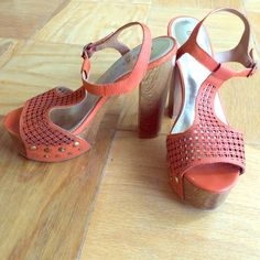 Orange Bakers Platform Sandals Worn twice with minimal signs of wear. Orange laser cut upper with wooden heel. Small scratches on heel but not very noticeable (as pictured). These work perfect with a maxi dress!!! Bakers Shoes Sandals