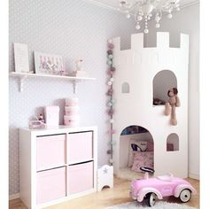 Pink fantasy little girl's room with a castle tower for reading and storage. - Pink fantasy little girl's room with a castle tower for reading and storage.