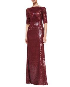 Jenny Packham Allover Sequin & Bead Embellished Gown       •Jenny Packham allover sequin gown with beaded sides. •Bateau neckline. •Half sleeves. •A-line skirt falls to floor.