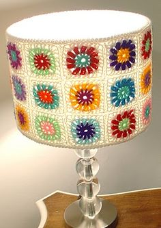 granny squares lamp, we could also embellish the lamp stand with crocheted climbing flowers, and make the granny squares more flower  oriented.