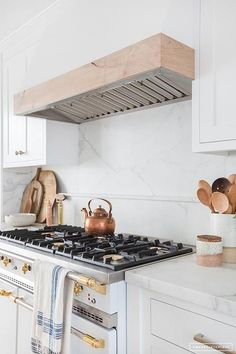 A large marble slab displays a classic cooktop backsplash design detailed with pencil tiles.
