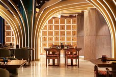 These strips distributed in the restaurant ceiling and overlapped with each other as palm leaves, this design helped to draw attention away from the open black ceiling and gave a visual depth.