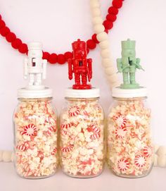 Having a Christmas party? Set these treat-filled jars out around your home for a festive snack that also doubles as decor. To make them, blogger Lexy Ward snagged some mini nutcrackers on at Hobby Lobby, spray-painted them, then glued them to the tops of her Mason jars.  Get the tutorial at The Proper Pinwheel.  - WomansDay.com