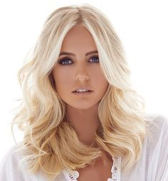 Soft, buttery blonde. We added soft highlights around the face to brighten the skin.