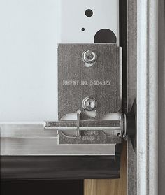 Garage door maintenance - bottom bracket. Visually inspect hardware for wear and tear. Look for bent or loose hinges, broken wheels, bent shafts or worn out bearings on steel rollers, and bent or misaligned track. Tighten or replace loose or missing bolts on the door and track supports.