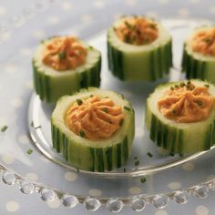 These peeled cucumber cups, with their holiday color scheme, look wonderfully festive, plus they're a snap to make. The rounds provide the perfect base for all manner of tasty fillings. Flavored hummus works well, as do other savory dips.  Holiday Cucumber Cups